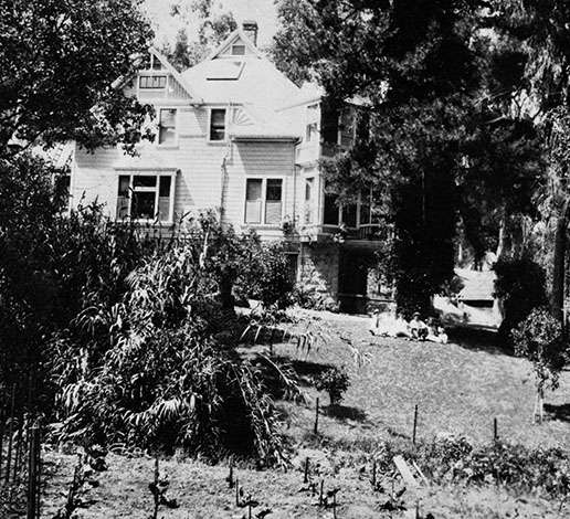 Side view of the J. Schram Victorian house and vegetable gardens, circa 1875