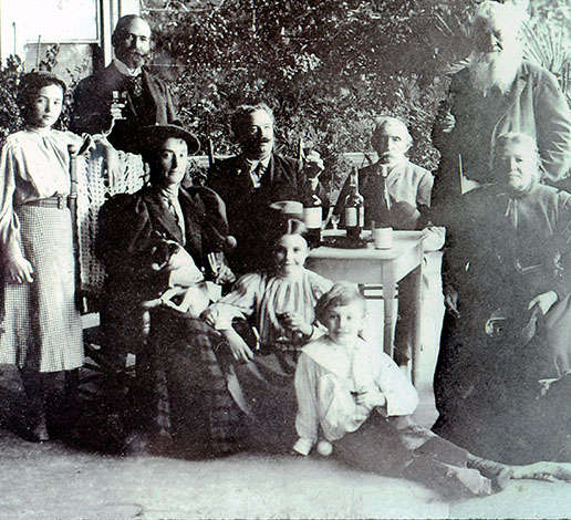 The Jacob Schram family sitting on the veranda of the Schramsberg Victorian house in 1890