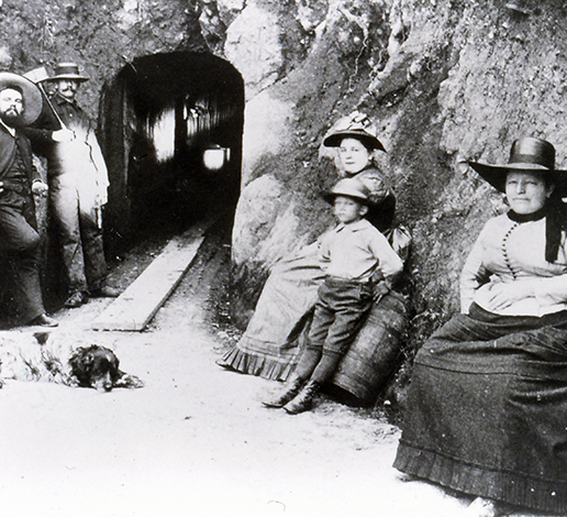 Annie Schram with her son Herman and cellar workers rest at entrance to Schramberg wines caves, circa 1890