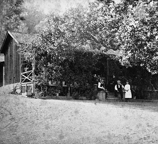 Jacob Schram family members gathered on steps of historic redwood cabin on Schramsberg property, circa 1862